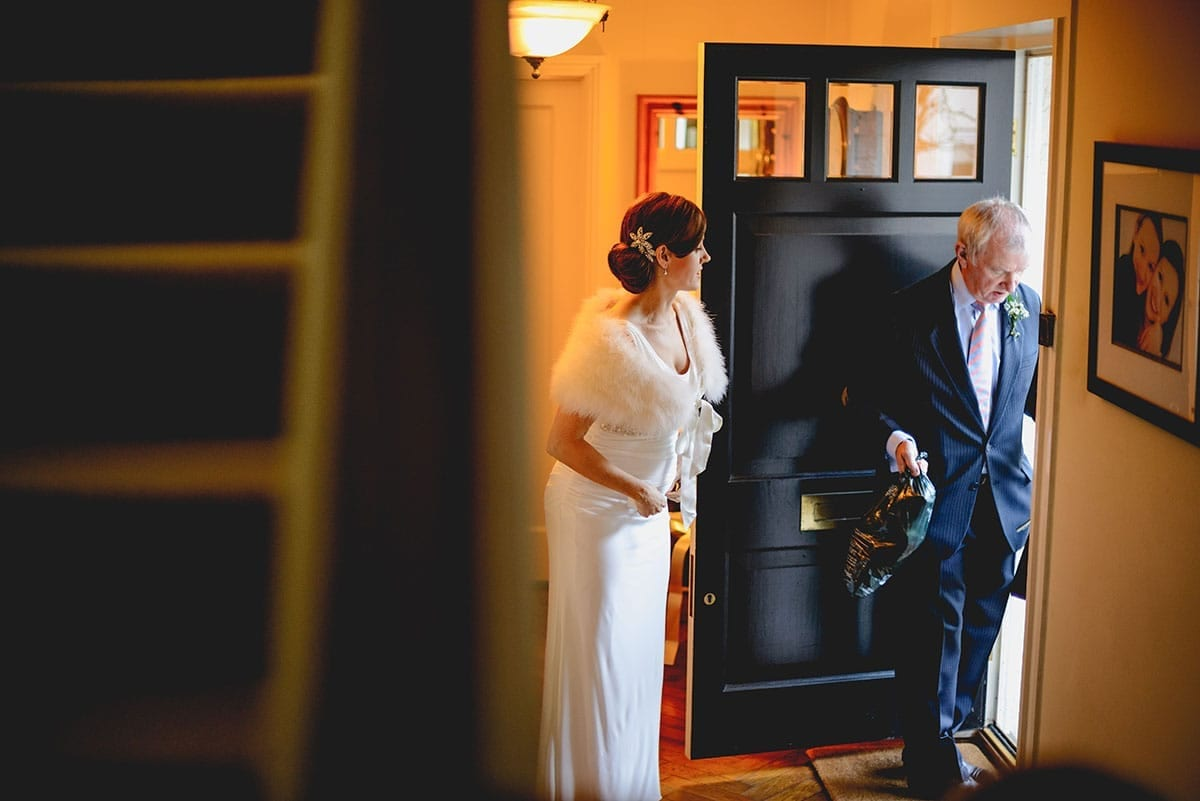 Bride gets ready to leave for the church. Loseley Park Wedding Photographer