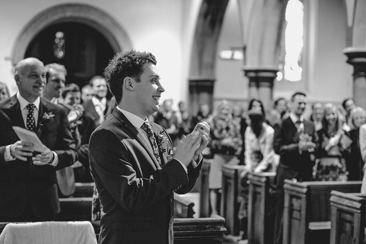Guests cheering at the Church. Loseley Park Wedding Photographer