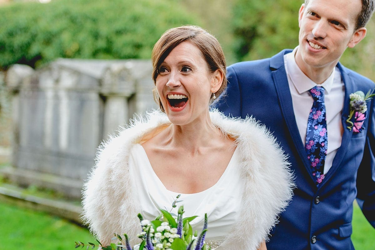 Brdie and groom exit church Loseley Park Wedding Photographer